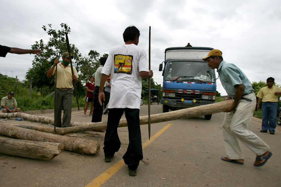 Natives holding a road blockage at the entrance of the Amazonian town of Yurimaguas, northern Peru June 9, let the lorries pass through for a couple of hours. AFP / Getty Images / Ernesto Benavides