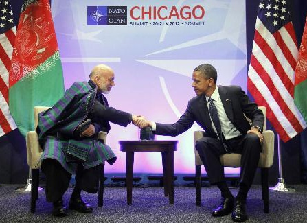 Hamid Karzai, President of Afghanistan (left) and Barack Obama, President of the United States (right) shake hands during the 2012 NATO summit in Chicago.