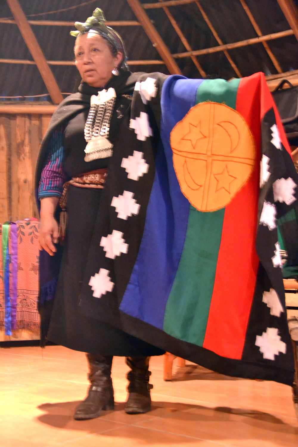 Mapuche-Elder-Explaining-Traditional-Flag-cc