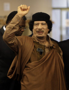 NEW YORK - SEPTEMBER 23: Libyan leader Col. Muammar Gaddafi gestures as he enters the U.N. headquarters for the United Nations General Assembly on September 23, 2009 in New York City. This is the 64th session of the United Nations General Assembly featuring leaders from over 120 countries. (Photo by Rick Gershon/Getty Images)
